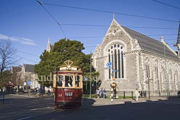 CHRISTCHURCH SOUTH ISLAND NEW ZEALAND May City tour tram passing the Arts Centre building