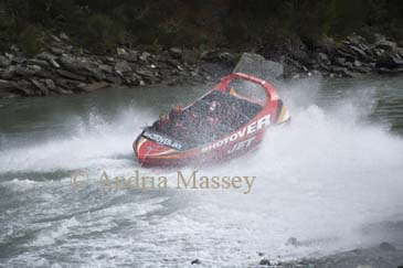 ARTHUR'S POINT QUEENSTOWN SOUTHERN LAKES SOUTH ISLAND NEW ZEALAND May The Shotover Jet Boat and passengers disappearing behind a wall of spray