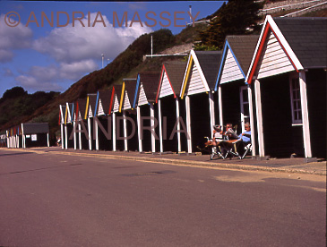 Bournemouth Dorset Sitting outside one of the colourful beach huts