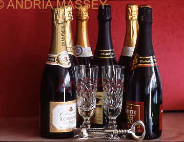Champagne bottles and flutes with a red background