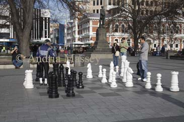 CHRISTCHURCH SOUTH ISLAND NEW ZEALAND May Interested spectators watching two men play chess in Cathedral Square