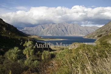 NR WANAKA SOUTHERN LAKES SOUTH ISLAND NEW ZEALAND May Looking across Lake Hawea towards the Southern Alps from a roadside viewpoint