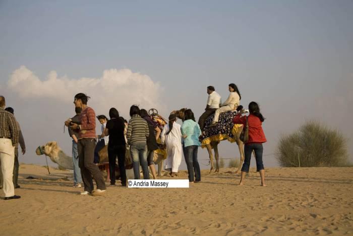 Dubai United Arab Emirates Tourists queuing for camel rides in the desert