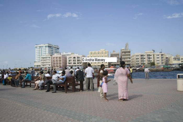 Dubai United Arab Emirates Group of Indians sitting outside in the sunshine having just left the mosque