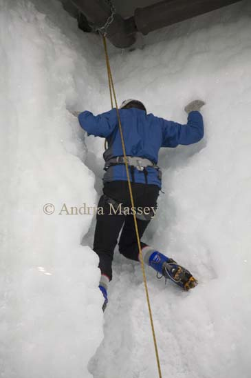 FRANZ JOSEF WEST COAST SOUTH ISLAND NEW ZEALAND May A woman climbing a ice chinmney one of the more difficult of the 15 climbing routes of the indoor ice climbing wall