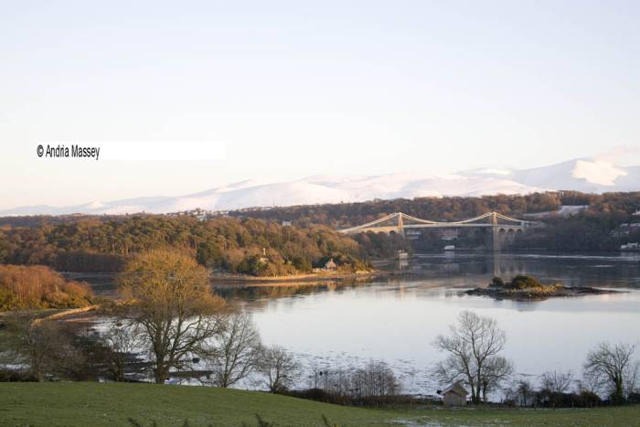 Isle of Anglesey North Wales January View across Menai Strait and Thomas Telford's Suspension bridge in late afternoon light