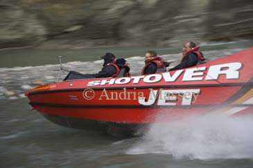 ARTHURS POINT QUEENSTOWN SOUTHERN LAKES SOUTH ISLAND NEW ZEALAND May The Shotover Jet Boat screams past taking tourists on a thrilling ride along the Shotover River Canyon