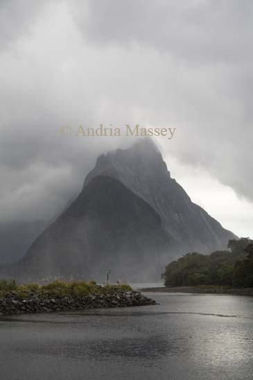 MILFORD SOUND SOUTHERN LAKES SOUTH ISLAND NEW ZEALAND May Looking to cloud covered Mitre Peak from the Visitor Centre in the Fiordland National Park