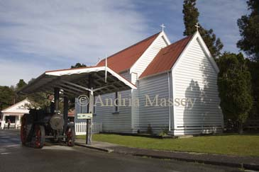 GREYMOUTH CENTRAL SOUTH ISLAND NEW ZEALAND May The preserved wooden church and a McLaren Traction engine in Shantytown a cultural and heritage experience