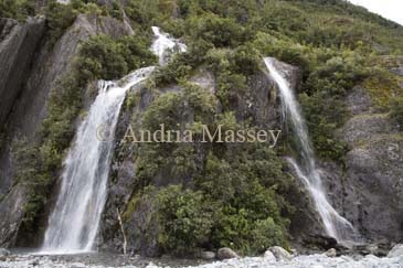 FRANZ JOSEF WEST COAST SOUTH ISLAND NEW ZEALAND May A waterfall in the Southern Alps close to the Franz Josef Glacier