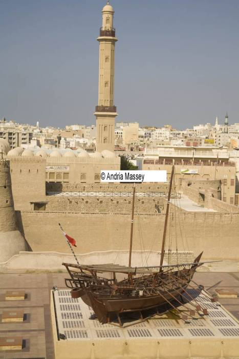 Dubai United Arab Emirates Looking down Al Fahidi Fort built in 1787 which houses the Dubai Museum with creative and imaginative displays with the Grand Mosque minaret in the background