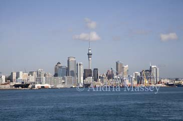 AUCKLAND NORTH ISLAND NEW ZEALAND May Looking back at the waterfront and Queens Wharf and Princes Wharf from a ferry in Waitemata Harbour
