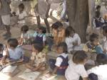 SANIA MADHYA PRADESH INDIA November School children having their lessons out of doors at the village Junior School