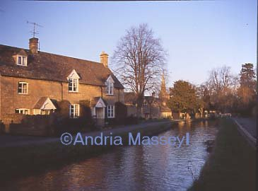 Lower Slaughter Gloucestershire -Looking up the main street - late evening  sun  Format: Medium