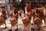 18th century band marching down Gloucester St Williamsburg USA