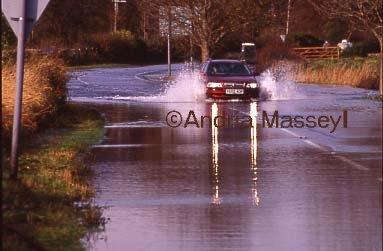 Car driving along flooded road Lavant West Sussex  Format: 35mm